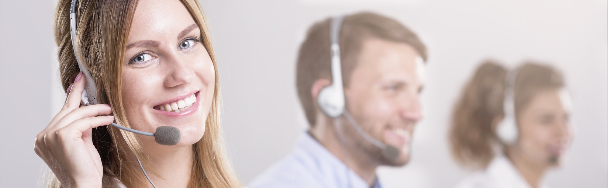 Woman with headphones working in call centre